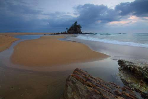 beach sea water cliff sky