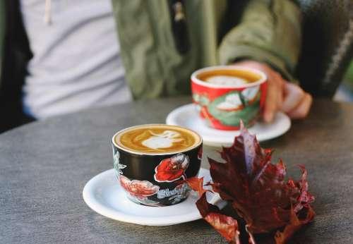 cup saucer coffee art latte