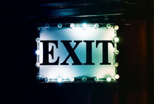exit sign neon typography lights
