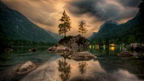 trees landscape lake reflection thunderstorm