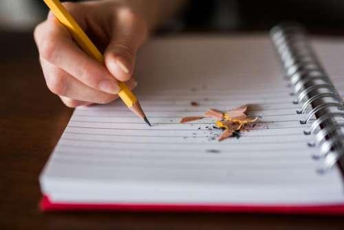 notebook pencil write school blur