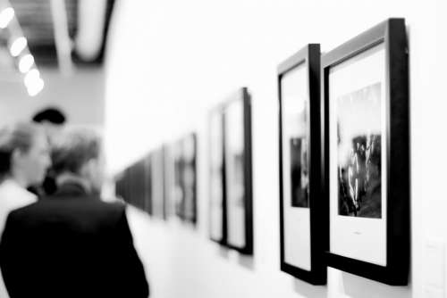 black and white photos frame wall people