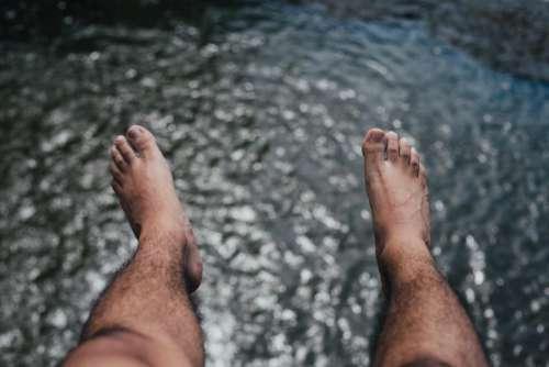feet legs lake river water