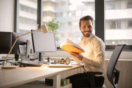 man smiling office work desk