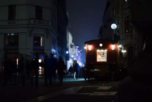 bucharest night city lights people