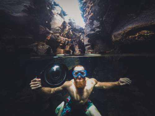 camera people man swimming water