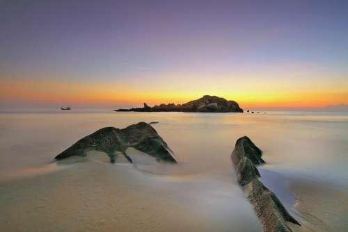 white sand beach sea water