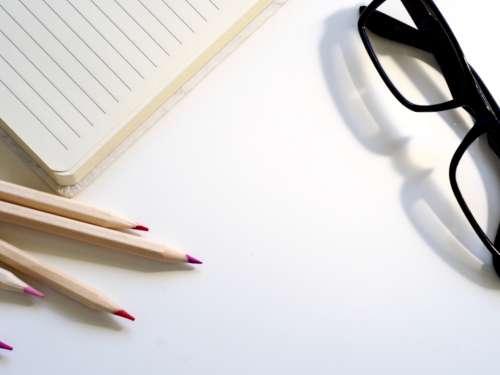 notepad pencils glasses writer writing
