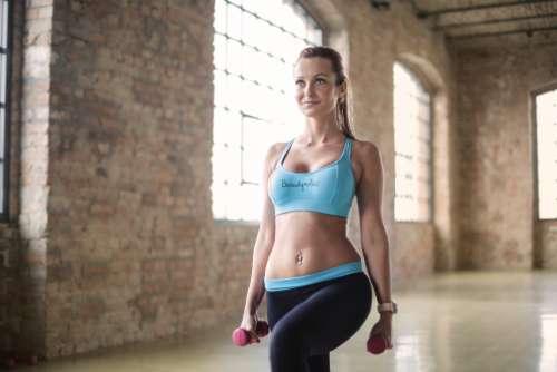 woman workout weights sport blue