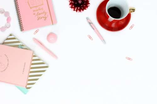 workplace desk feminine pink notebooks