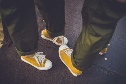 yellow shoe footwear pants couple