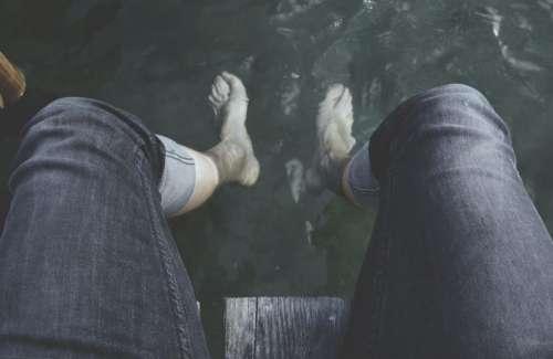 people feet water ocean sea