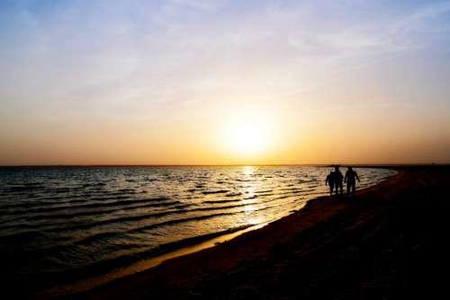 sunset beach friends tenderness friendship