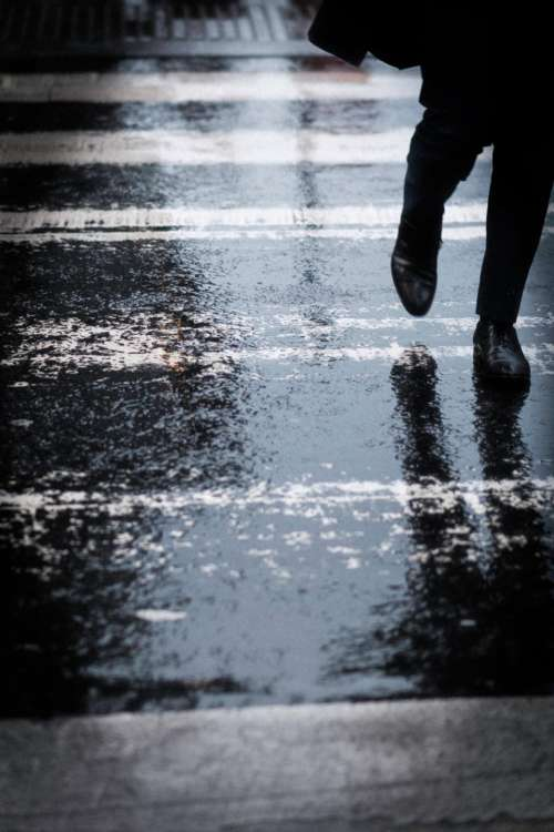people walking rain wet road