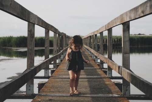 kid chils girl walking wooden