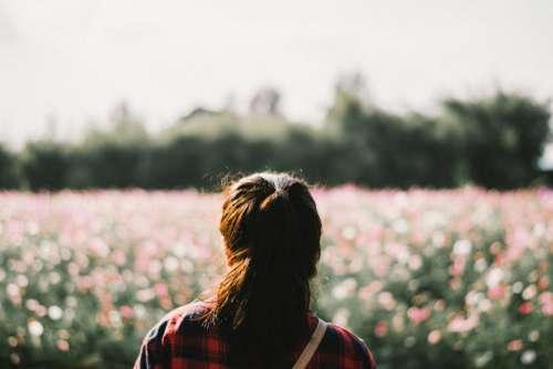 people woman alone field flowers