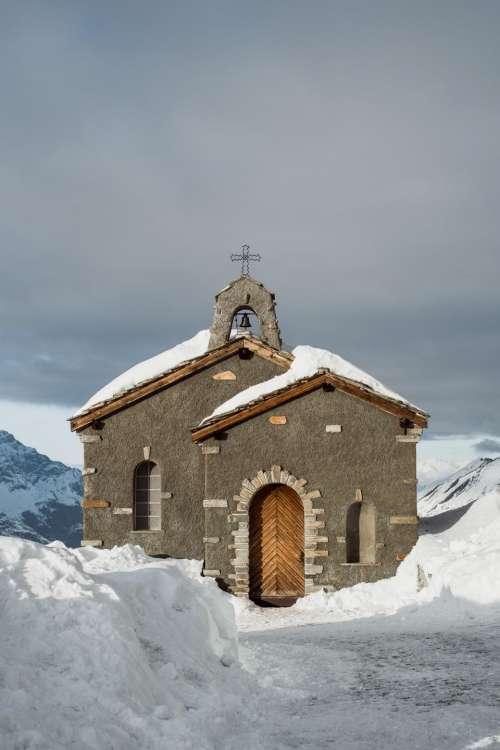 church cross bell winter snow