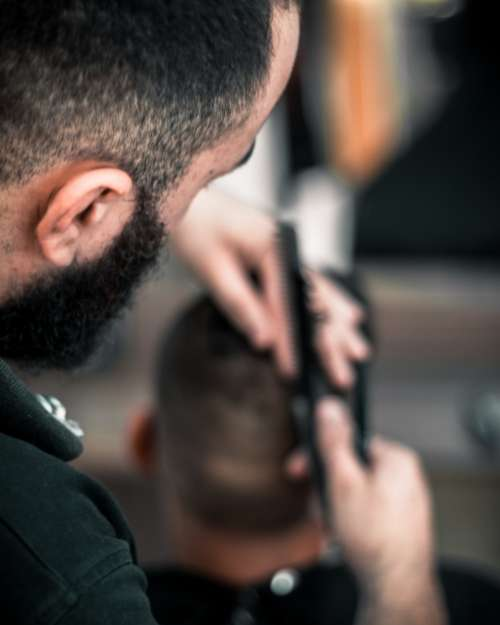 barber cutting hair man comb