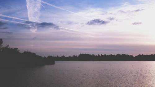 sunset dusk silhouette shadows lake