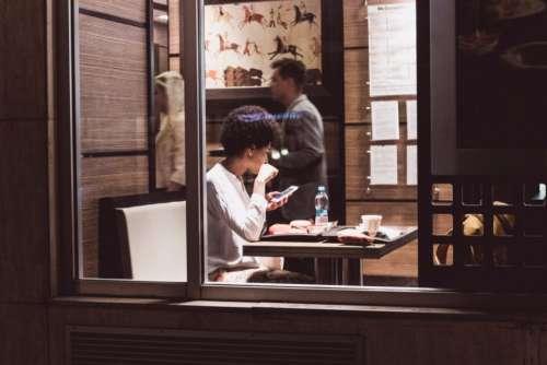 coffee woman smartphone mcdonald waiting