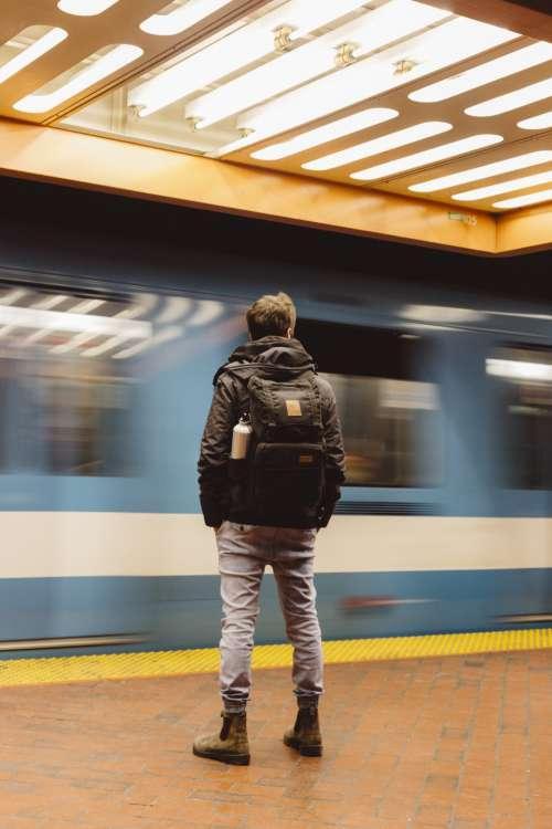 commuter waiting subway man male