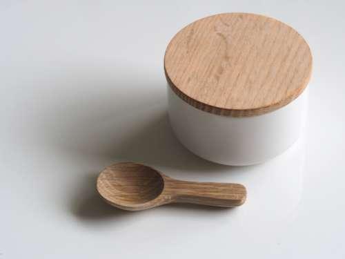 white bowl lid wood spoon