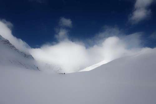 mountain snow winter clouds sky