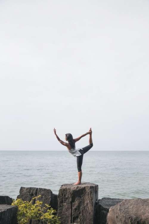 yoga stretch ocean water seaside