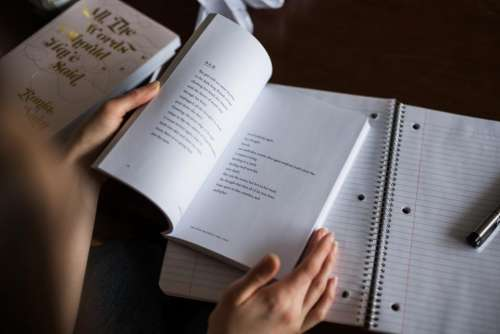 notes book pen hands reading