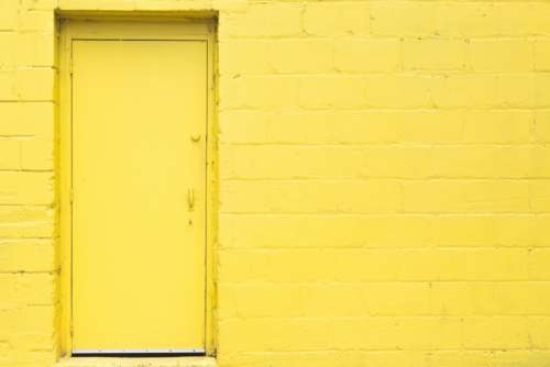 yellow door wall brick backgrounds