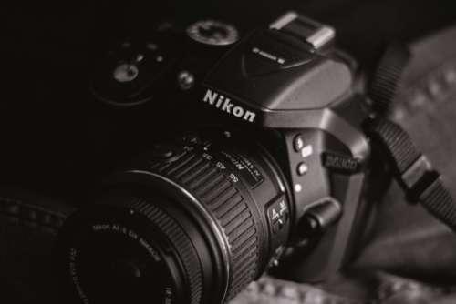 black dslr camera nikon lens