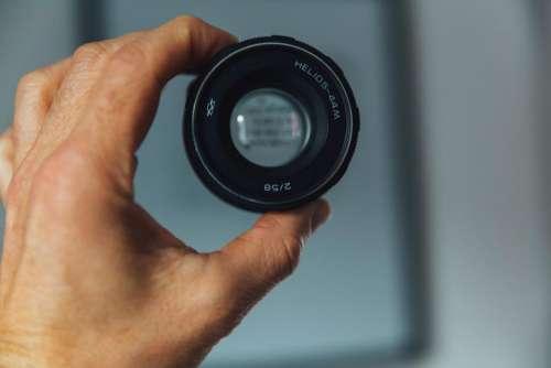 hand camera lens black blur