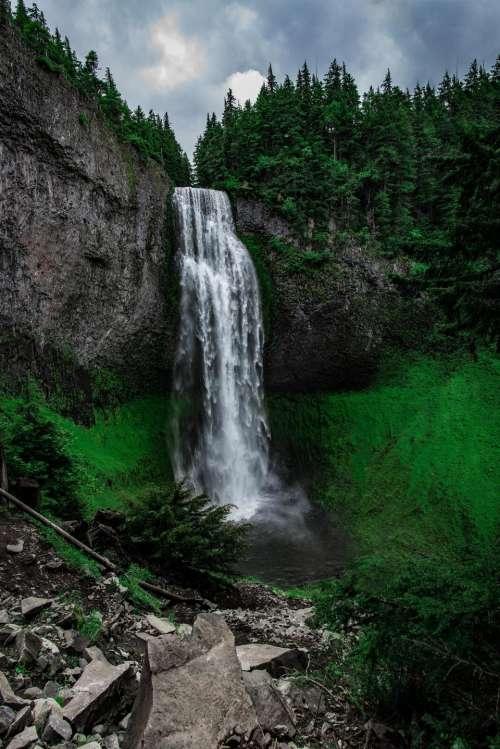waterfalls green grass hill trees