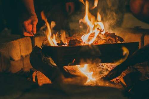 fire bonfire flames logs heat