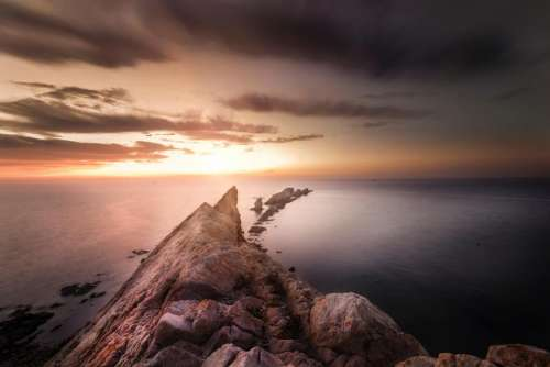 sea ocean water rock hill