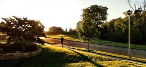 people man walking alone sunlight