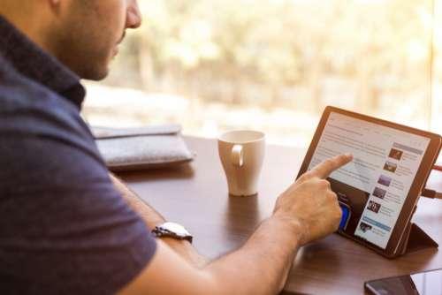 man reading ipad tablet techonology
