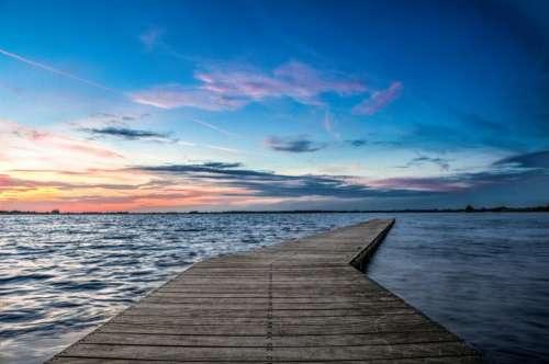 pier dock lake water horizon
