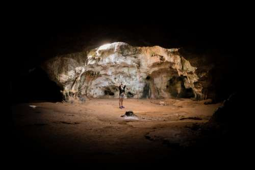 people woman alone cave light