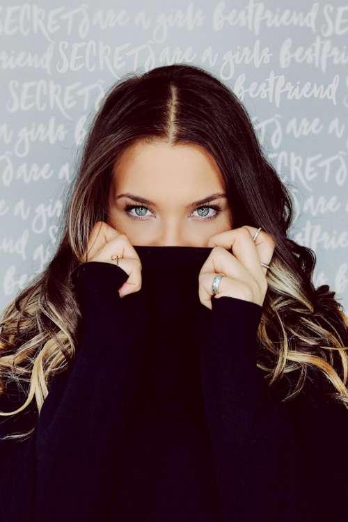 woman jumper black sparkly eyes