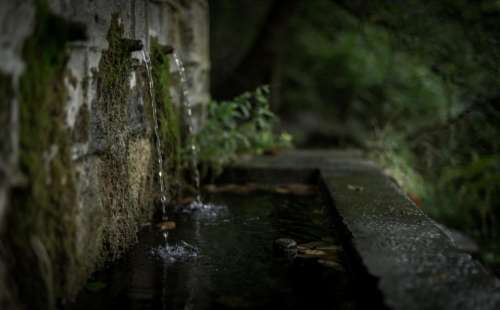 wall water drainage blur dark