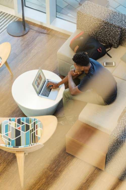 man browsing laptop work business