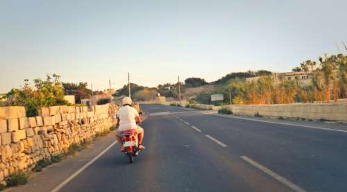 moped road man alone isolated