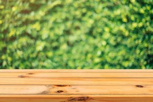 wood wooden table outside bokeh
