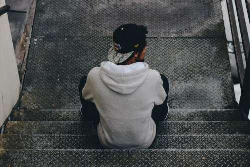 people alone man sitting waiting