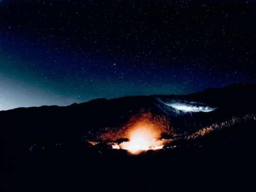 landscape fire night stars mountains