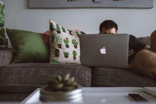 man laptop couch macbook mac