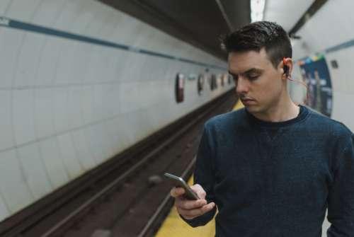 man subway mobile phone telephone