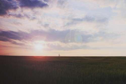 sunset sky clouds field grass