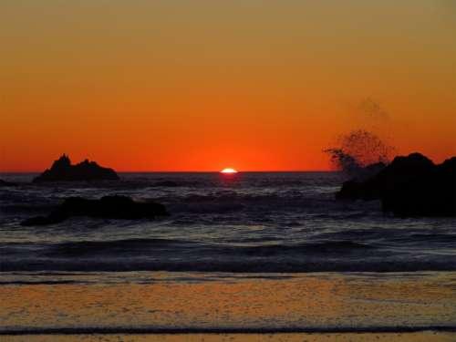 warm ocean sunset waves splashing